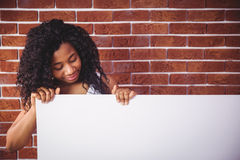 Smiling woman holding white board Stock Images