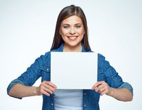 Smiling woman holding white sign board. Casual dressed girl with advertising banner Royalty Free Stock Photos