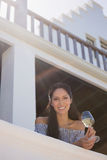 Smiling woman holding white wine glass in restaurant Royalty Free Stock Photo