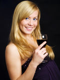 Smiling woman holding wine and celebrating Royalty Free Stock Images
