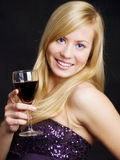 Smiling woman holding wine and celebrating Stock Photo