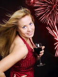 Smiling woman holding wine and celebrating Royalty Free Stock Image