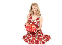 Smiling woman holding a wrapped present Stock Images