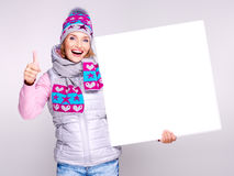 Smiling  woman  holds the banner with thumbs up sign Royalty Free Stock Photo
