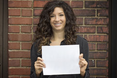 Smiling Woman Holds Blank Paper Royalty Free Stock Photography