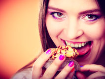 Smiling woman holds cake in hand Stock Photography