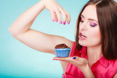 Smiling woman holds chocolate cake in hand Stock Image