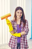 Smiling woman holds a foam rubber brush in her hands Royalty Free Stock Photography