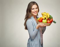 Smiling woman holds straw basket with healthy food Royalty Free Stock Images