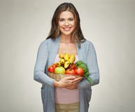 Smiling woman holds straw basket with healthy food Royalty Free Stock Photo