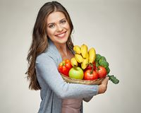 Smiling woman holds straw basket with healthy food Stock Photo