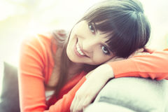 Smiling woman at home stock photo