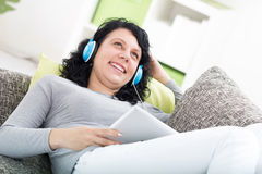 Smiling woman at home listen music Stock Photo