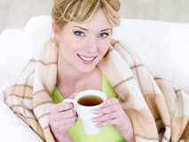 Smiling woman with hot cup of coffee Stock Image