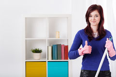 Smiling woman during housework Royalty Free Stock Images