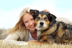 Smiling Woman Hugging German Shepherd Dog Royalty Free Stock Photos