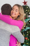 Smiling woman hugging her boyfriend Stock Photo