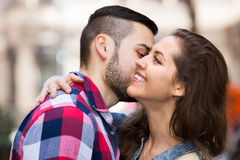 Smiling woman hugging her male Stock Images
