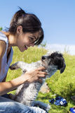 Smiling woman hugging her white  dog outdoor Royalty Free Stock Images