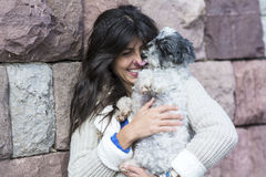Smiling woman hugging  her white  dog outdoor Royalty Free Stock Photos