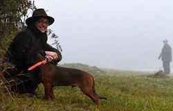 Smiling woman hunter with dog Royalty Free Stock Images