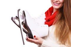 Smiling woman with ice skates Stock Photos