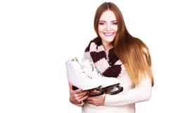 Smiling woman with ice skates Stock Photo