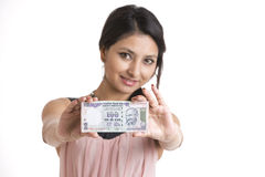Smiling Woman with indian currency note Royalty Free Stock Images