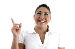 Smiling woman indicating back side Royalty Free Stock Images