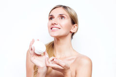Smiling woman with a jar of face cream. Beauty concept. Stock Photo