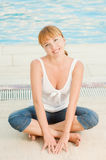 Smiling woman in jeans nearby pool royalty free stock photos