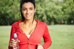 Smiling woman jogging in nature Royalty Free Stock Photo
