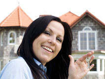 Smiling woman with keys Royalty Free Stock Image