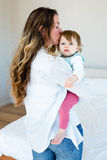 smiling woman kissing an adorable baby Royalty Free Stock Photos