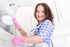 Smiling woman in kitchen Royalty Free Stock Photos