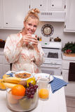 Smiling Woman In Kitchen Royalty Free Stock Image