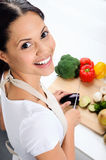 Smiling woman in the kitchen Stock Photo