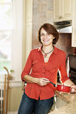 Smiling woman in kitchen at home Royalty Free Stock Photos