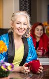 Smiling Woman in Kitchen in robe royalty free stock image