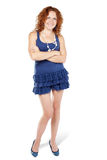 Smiling woman in knitted dress stands Stock Photo