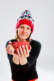 Smiling woman in knitted hat holding cup Stock Photo