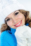 Smiling woman in knitted sweater, hat, and gloves Royalty Free Stock Photography