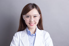 Smiling woman lab technician. Isolated on gray background, asian Royalty Free Stock Image