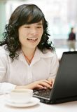 Smiling woman with laptop Royalty Free Stock Photography