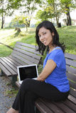 Smiling woman with laptop Royalty Free Stock Photo