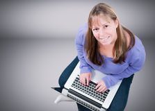 Smiling woman with laptop Royalty Free Stock Photos