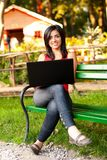 Smiling woman with laptop Royalty Free Stock Images