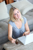 Smiling woman with laptop computer royalty free stock photos