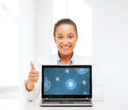 Smiling woman with laptop computer Stock Photography