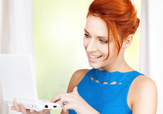 Smiling woman with laptop computer Royalty Free Stock Photo